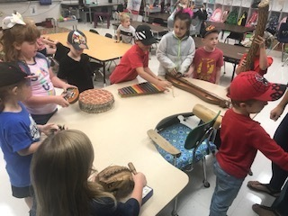 Students play some of the instruments.